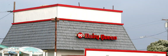 Dairy Queen building on Pacific Coast Highway with red trim in Huntington Beach California