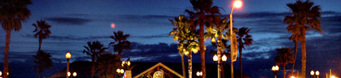 Dukes at night, diners overlooking Pacific Ocean and Pier, fresh fish, shrip and salads