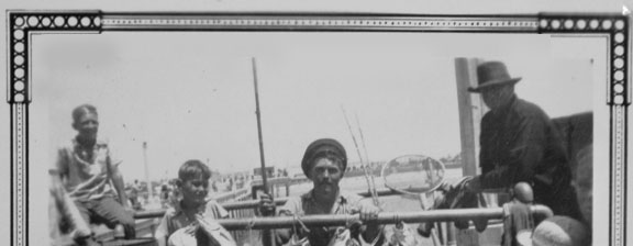 Historic photo of fisherman and catch at Huntington Beach early 1900s