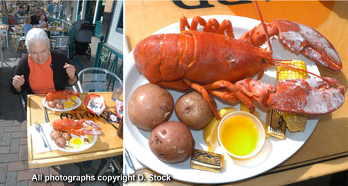 Longboard Restaurant and Pub food plate at outdoor dining table with lobster served with butter, corn and potatoes